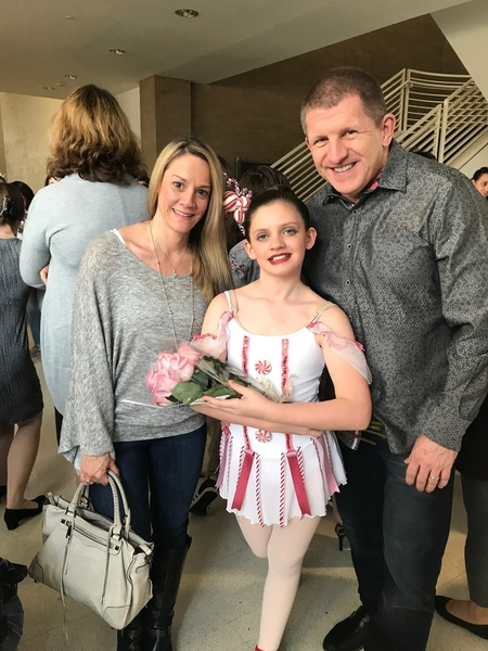 Jamie and her parents after a ballet performance