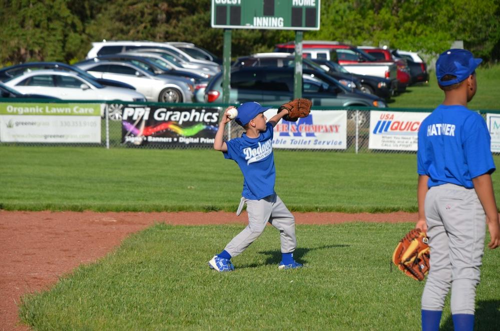 Aiden playing baseball